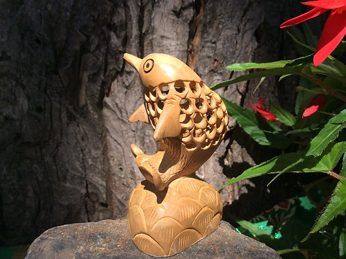 Hand sculpted in natural wood dolphin  from India, 9 cm
