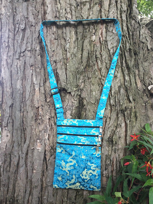 Bag in blue satin with weaved in golden dragon patterns