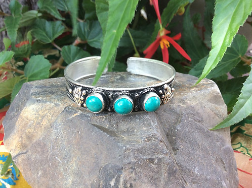 Cuff bracelet handcrafted in India with three blue howlite gemstones