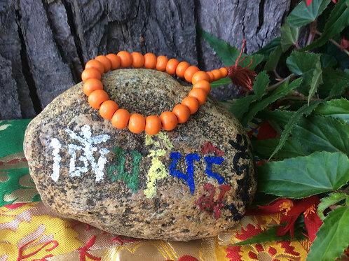 Buddhist whrist mala with orange bone beads