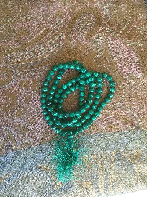 Buddhist mala with natural malachite beads