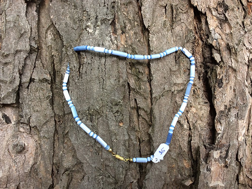 Necklace handcrafted in India in blue tubelike beads of iridescent glass