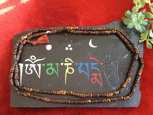 Buddhist mala with brown bone beads 140 cm