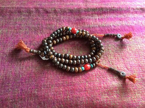 Buddhist mala in brown bone beads 68 cm