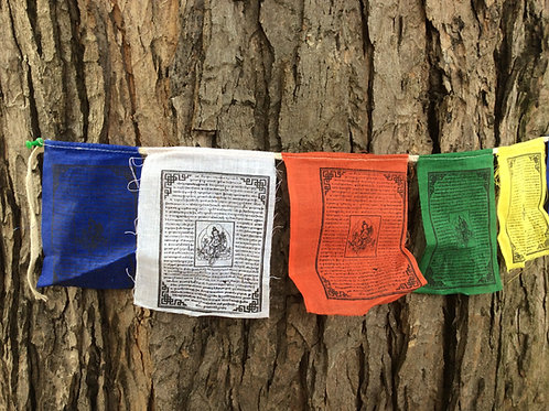 Prayer flags with Tara buddha