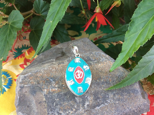 Pendant in tin with turquoise and red inserts of Compassion Mantra