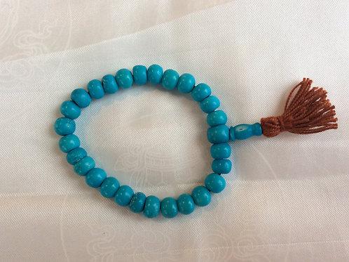 Bracelet mala en os coloré bleu clair
