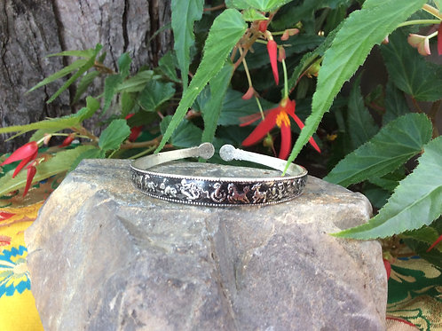 White metal Cuff Bracelet handcrafted in India with oriental zodiac signs