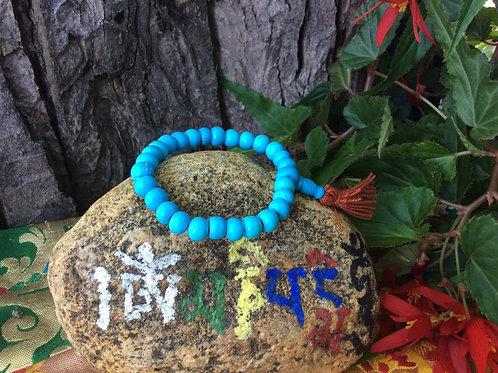 Buddhist wrist mala with bone turquoise beads