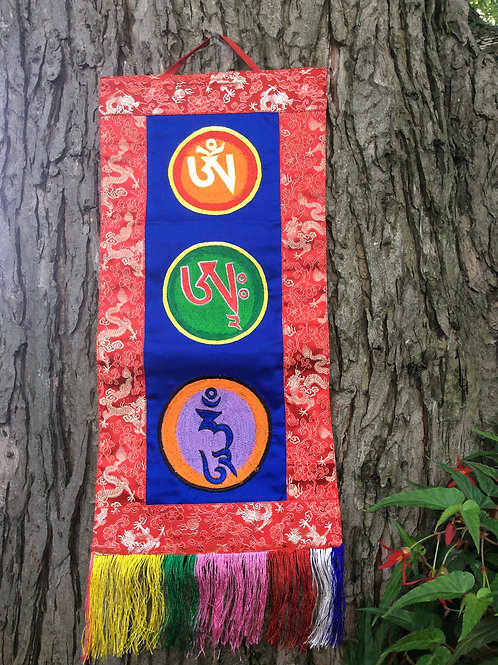Banner of Body, Speech and Spirit Mantra in red and blue silk and coton fabric