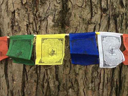 Buddhist prayer flags with Tara buddha