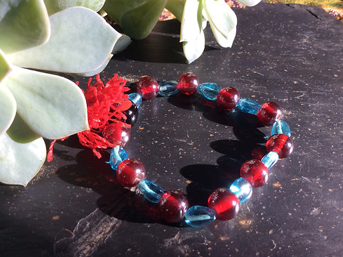 Bracelet of red and blue glass beads on elastic string
