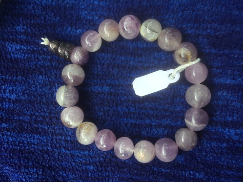 Bracelet with tumbled amethyst beads,  on an elastic string