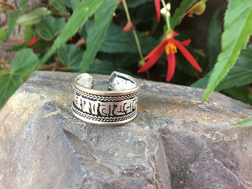 Metal ring handcrafted in India with Compassion Mantra