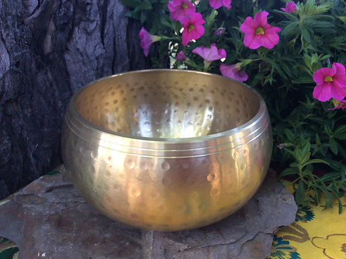 Tibetan singing bowl 12 cm, shining golden finish marked hammer strokes
