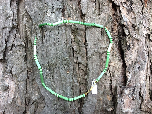 Necklace handcrafted in India ingreen tubelike irridescent glass beads