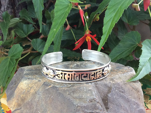 White metal Cuff Bracelet handcrafted in India with Compassion Mantra inlaid