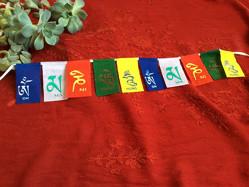 Mini prayer flags on Compassion Mantra