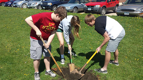 students digging hole