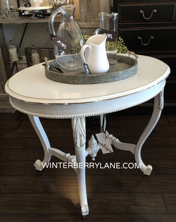 ANTIQUE OVAL TABLE ON CASTERS