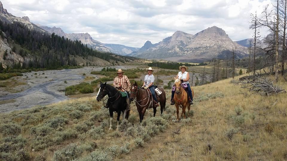 three horses and riders