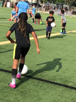 kids-kicking-soccer-ball