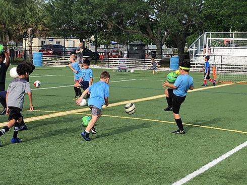 kids-playing-soccer.jpeg