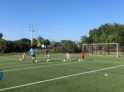 kids-doing-soccer-drills