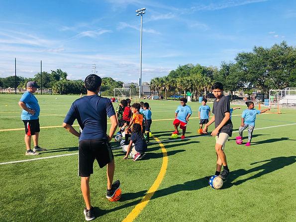 soccer-coaches-teaching-kids