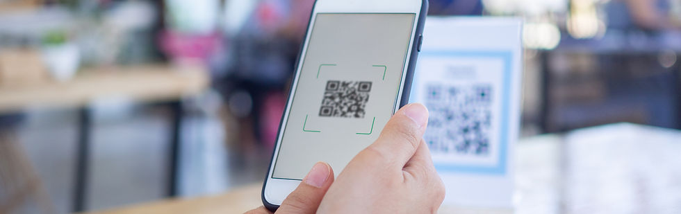 Hands using phone to scan QR code