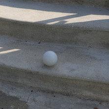 Clean Slate with Grey Sphere In Shadow