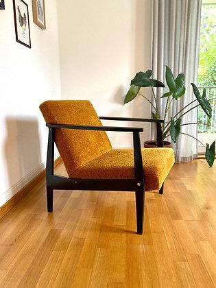 Yellow midcentury easy chair
