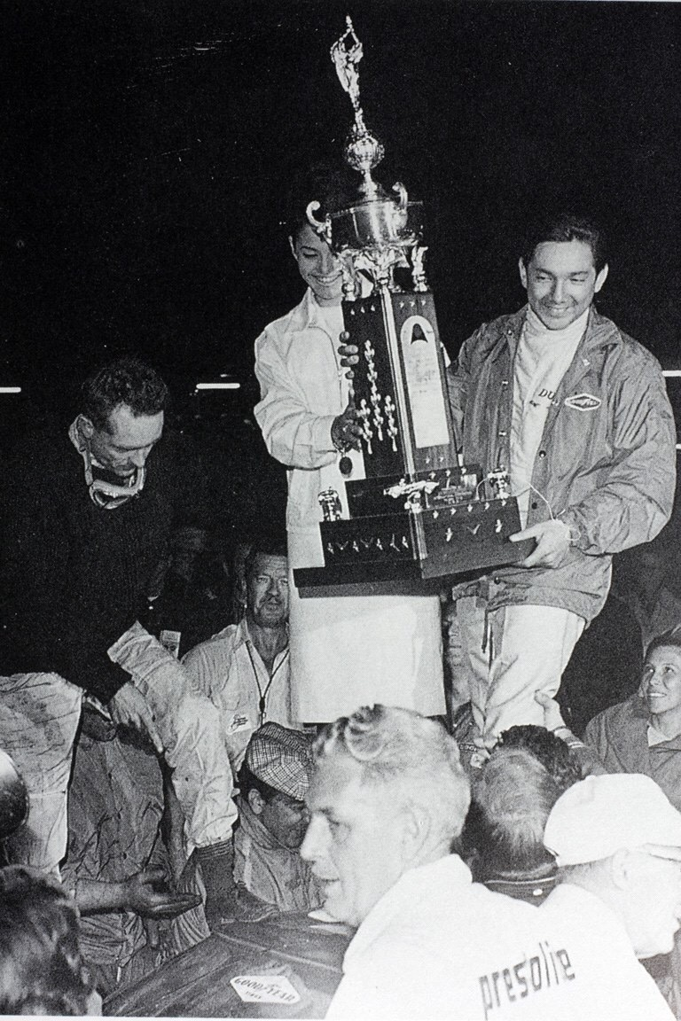 P. Hill, Ms. Universe & P. Rordriguez celebrate their win at the '64 Daytona 2000km with a Ferrari 2