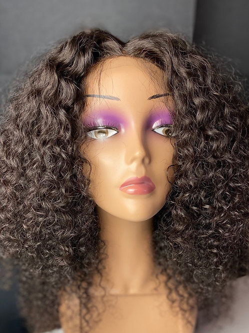 18 'inch Indian unprocessed virgin hair unit \ wig with a natural curly texture