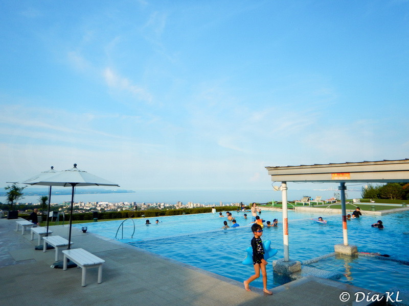 Onsen pool on a hotel, here you bathe with swimming suit and have nice views over the town. Beppu, Oita prefecture, Kyushu, Japan
