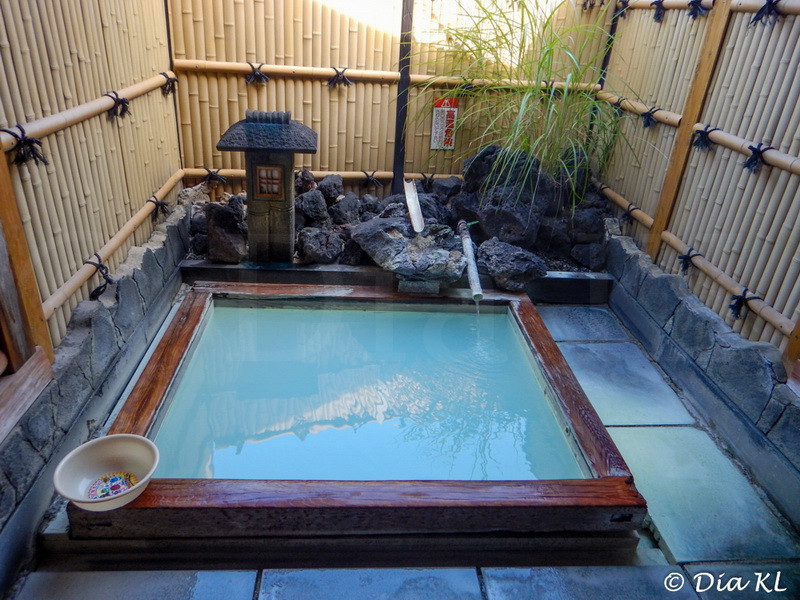 Sulfuric outdoor onsen (hot spring) with blue water in Beppu, Oita Prefecture, Kyushu, Japan