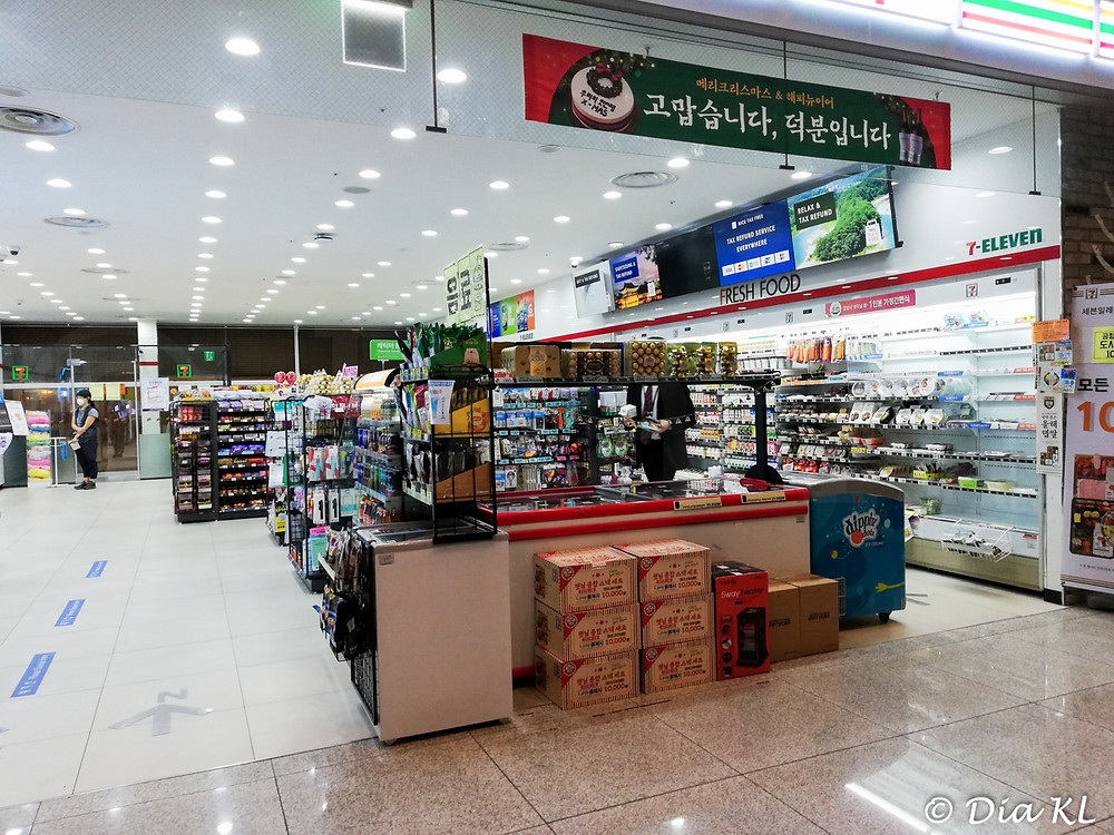 7-11 convenient store in Terminal 2 is the only place open 24h. Incheon internationl airport, South Korea. January 2021. Covid 19 pandemic second wave.