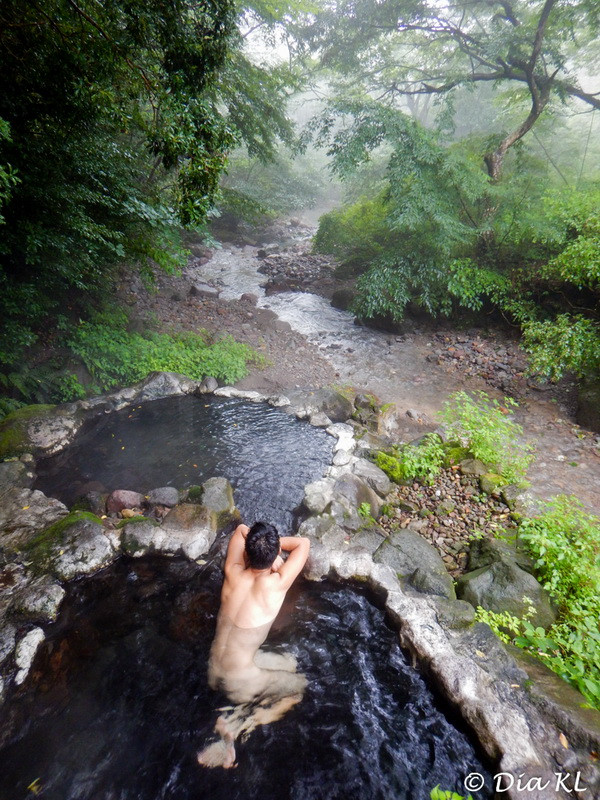 Mixed outdoor onsen up in the mountain, next to a stream. Beppu, Oita prefecture, Kyushu, Japan