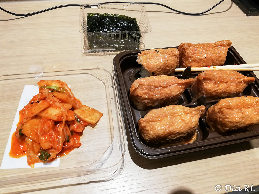 My dinner from 7-11: Korean dry seaweed, kimchi and inarizushi. Incheon international airport. January 2021. Covid19 pandemic second wave.