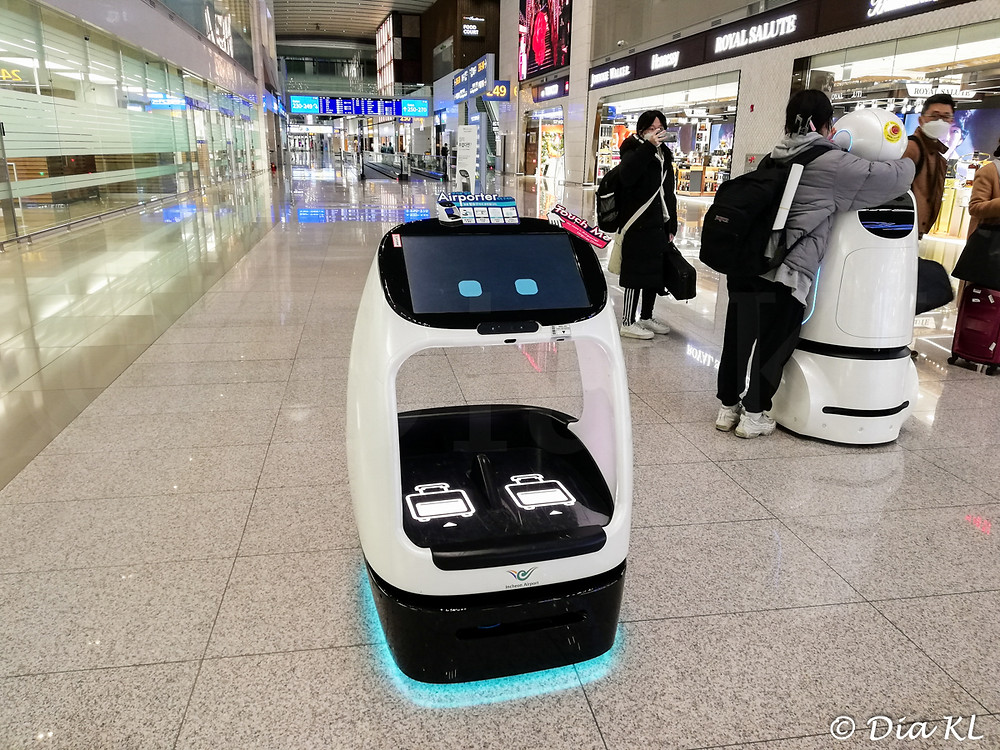 Robot to carry your hand luggage! Incheon international airport, South Korea. January 2021. Covid19 pandemic second wave.