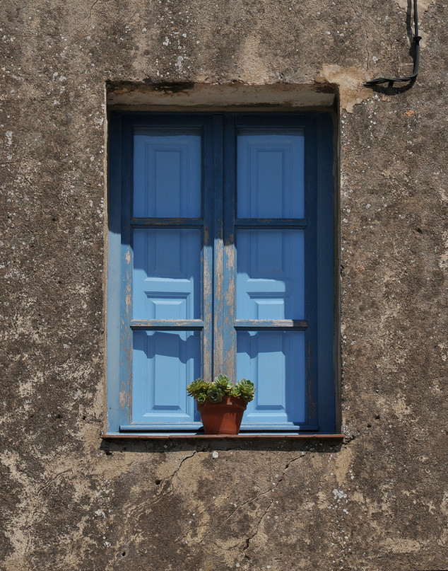 Concrete Wall and Blue Window