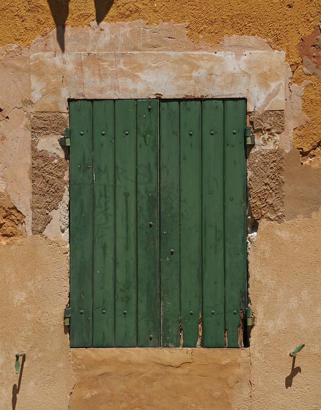 Rust wall Green shutters