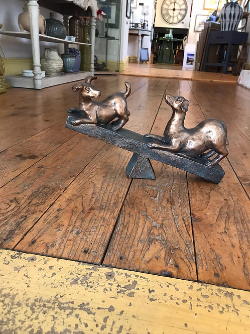 Dogs On A Seesaw