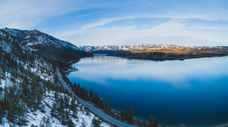 Winter's thaw beginning across Lake Chelan, WA. A combination of twelve exposures taken from a drone camera 400 feet above the mountains.