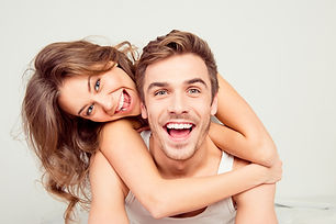 Cheerful smiling couple in love hugging