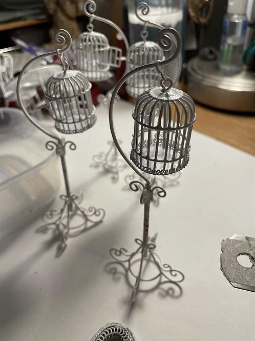 white wire bird cage on stand
