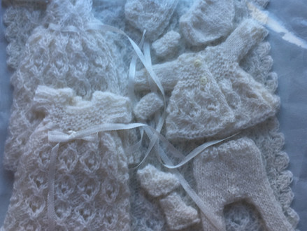 We have just received a wonderful donation from Isobel Hockey - A gorgeous hand knitted baby layette
