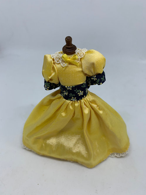 Yellow Children's Dress on Mannequin