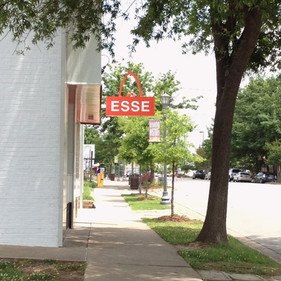 ESSE Purse Museum identity wall mount sign