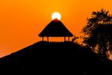 Sunset over beach shack